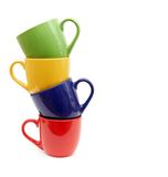 Color cups on a white background. Royalty Free Stock Images