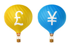 Color currency hot air balloons: pound, yen. Color currency hot air balloons - pound, yen Stock Photo