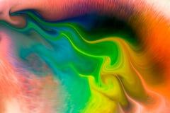 Color de fondo que fluye abstracto a través de la leche Fotos de archivo