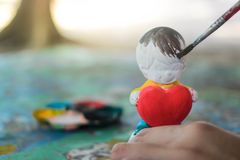 Color de la pintura en la muñeca del yeso Imagen de archivo libre de regalías