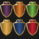 Color de oro del escudo Imagen de archivo libre de regalías