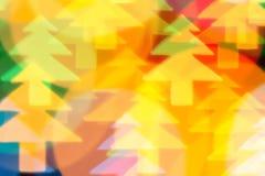 Color defocused bokeh of christmas fir-tree lights Stock Photography