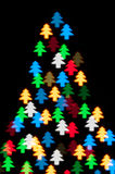 Color defocused bokeh of christmas fir-tree lights Stock Photos
