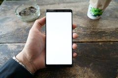 Color del negro del teléfono del juego del hombre imágenes de archivo libres de regalías