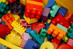 Color designer blocks. Designer blocks. Plastic toy blocks, kids toys constructor stock photos