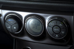 Color detail with the air conditioning button inside a car Royalty Free Stock Photos