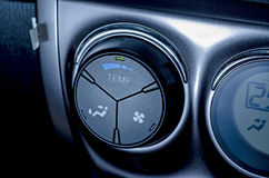Color detail with the air conditioning button inside a car .Blue-toned. Royalty Free Stock Photography