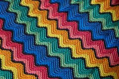 Color detail blankets. Detail of colorful knitted blankets pillows Stock Image