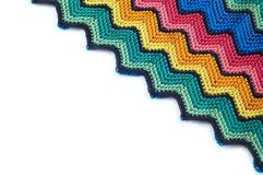 Color detail blankets. Detail of colorful knitted blankets pillows Royalty Free Stock Photo