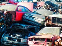 Color detail photography of cars scrapyard with cars wreckage. Color detail photography of cars scrapyard with old, rusty and damaged cars wreckage Royalty Free Stock Images