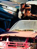 Color detail photography of cars scrapyard with cars wreckage. Color detail photography of cars scrapyard with old, rusty and damaged cars wreckage Stock Photo
