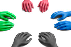 Color discussion-2. Multicolored plasticine hands on a white background Royalty Free Stock Photo