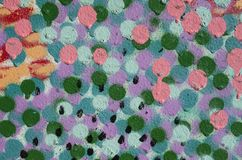 Color dots with paint closeup. On wall Stock Photos