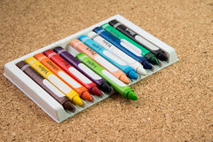 Color drawing crayons on a cork board Royalty Free Stock Image