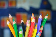 Color drawing pencils on a kids drawing background. Set of color drawing pencils on a kids drawing background stock photos