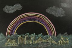 Color drawing rainbow over the city on the black background Royalty Free Stock Images