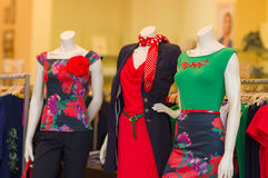 Color dresses and suits on mannequins in mall Royalty Free Stock Photography