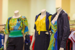 Color dresses and suits on mannequins in mall Stock Photo