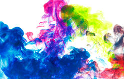 Color drop underwater creating a silk drapery. Ink swirling underwater. Cloud of colorful ink Stock Image