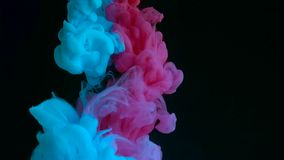 Color drop underwater creating a silk drapery. Ink swirling underwater stock video footage