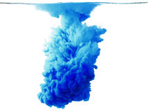 Color drop in water, photographed motion. Royalty Free Stock Photo