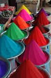 Color dyes in market. Piles of colorful dyes for sale in market, Mysore, India Stock Photos