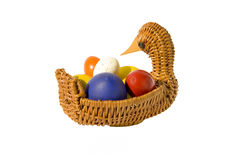 Color Easter eggs in basket Royalty Free Stock Photos