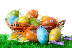 Color easter eggs in basket royalty free stock photography