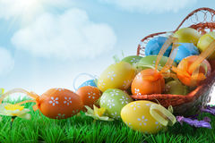 Color easter eggs in basket against blue sky Royalty Free Stock Photos