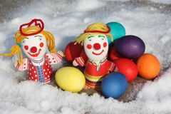 Color Easter eggs with a toy figure of the little man Royalty Free Stock Photos