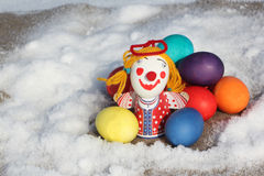 Color Easter eggs with a toy figure of the little man Stock Photography