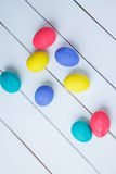 Color Easter eggs on wooden background Stock Photography