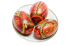 Color eggs on plate Stock Photos