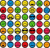 Color Emoticons. A set of 49 simple emoticons displaying different emotions such as happy, smiling, sad, angry Stock Images