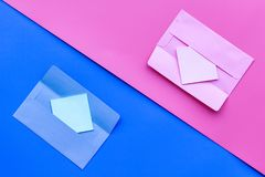 Color envelope on pink and blue pastel background top view copy space pattern. Color envelope on pink and blue pastel background top view Royalty Free Stock Photo