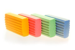 Color erasers. Photo of four color erasers Stock Photos