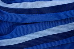 Color fabric texture with stripes on the sleeves. Of old clothes Stock Photography