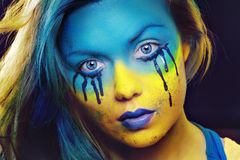 Color face art. Crazy color face art woman portrait with yellow and blue as flag of Urkaine Stock Images