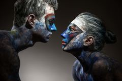 Color faces art. Portrait of a color faces art of couple in love stock images