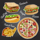 Color fast food on a black board Stock Photography