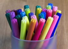 Color felt tip pens. On a wood background royalty free stock photo