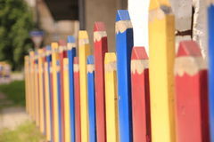 Color fence beyond the house Royalty Free Stock Photography