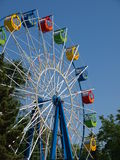 Color ferris wheel. Empty ferris wheel in the spring amusement park awaits visitors stock photography