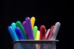 Color fibre pens. Over black Stock Photos