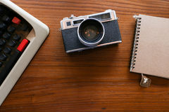 Color film camera and vintage antique typewriter with a notebook - Top view with copy space. Color film camera and vintage antique typewriter with a notebook Royalty Free Stock Image