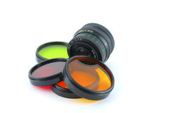 Color filters and old lens. Over white Stock Image