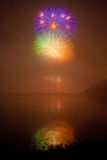 Color fireworks on lake Stock Photography