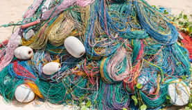 Color Fishing net, floats, nylon rope on the bank Stock Images