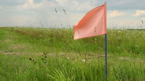 Color flag on field, signal flag for landing field airplanes stock video