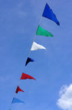 Color flags. Against the blue sky Stock Images